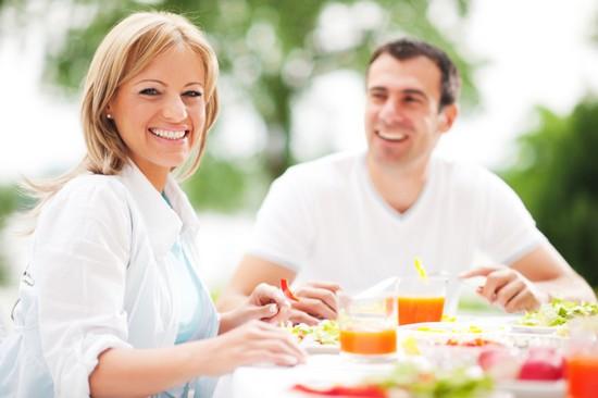 Couple having dinner outdoors.